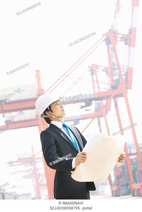 Businessman holding blueprint