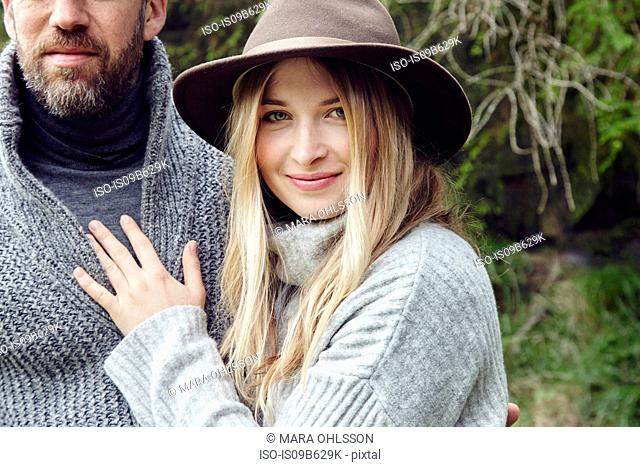 Cropped portrait of country couple in woodland