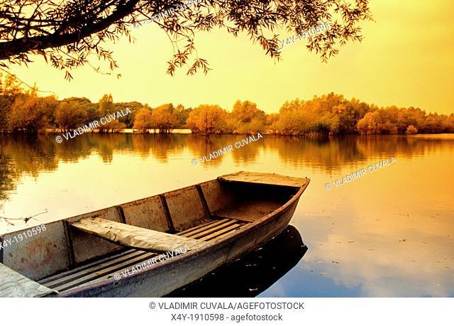 The fishing boat on the lake by the river Maly Dunaj near Kolarovo, Slovakia