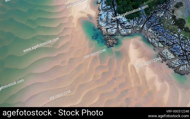 Aerial view of a river in low tide. Cantabria, Spain. Europe. 4K