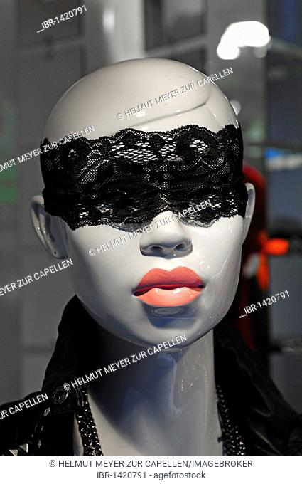 Female mannequin wearing a sleeping mask in a fashion shop, Nuremberg, Middle Franconia, Bavaria, Germany, Europe