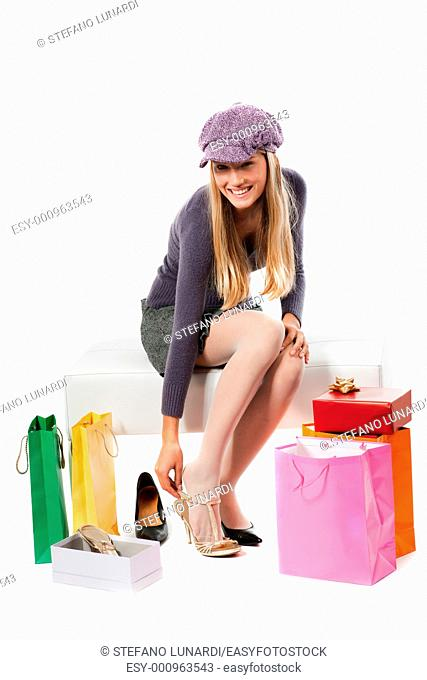 Beautiful young woman trying shoes on