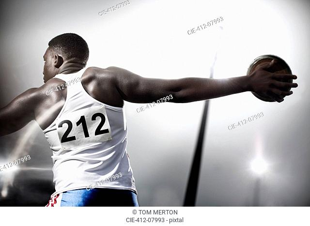 Track and field athlete throwing discus