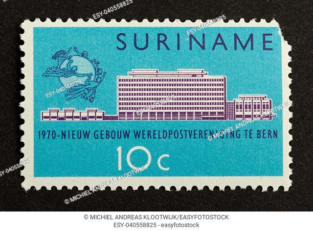 SURINAME - CIRCA 1970: Stamp printed in Suriname shows a a large building, circa 1970