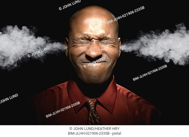 African man with steam coming out of ears