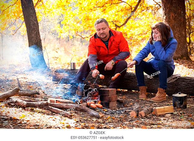 dad with daughter on picnic in the autumn forest