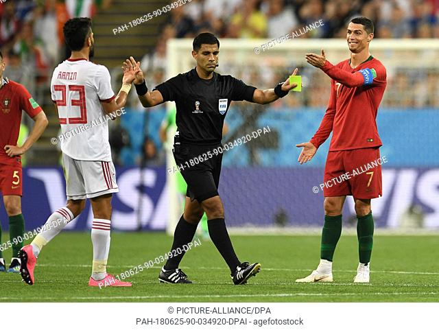 25 June 2018, Russia, Saransk: Soccer: FIFA World Cup 2018, Iran vs Portugal, group stages, group B, 3rd matchday: Referee Enrique Caceres (C) calms down...