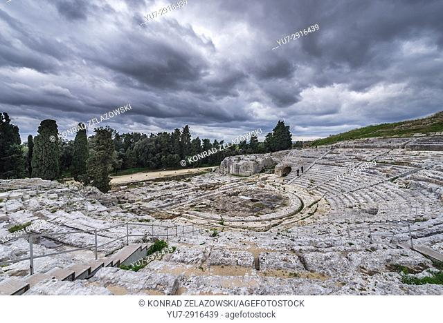 Ancient ruins of Greek Theater from 5th century BC in Neapolis Archaeological Park in Syracuse city, southeast corner of the island of Sicily, Italy