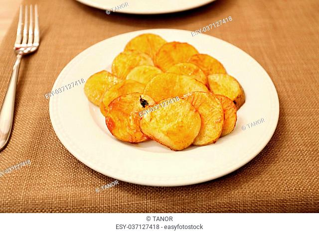 Tasty dish baked potato slices on a platter