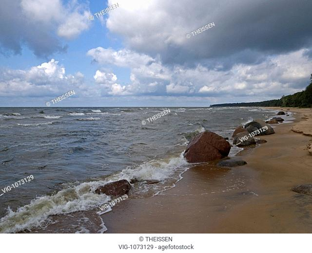 long beach with boulders, granit stones at Baltic Sea in grey windy weather near by Tuja in Latvia, Baltic states . - 19/08/2008