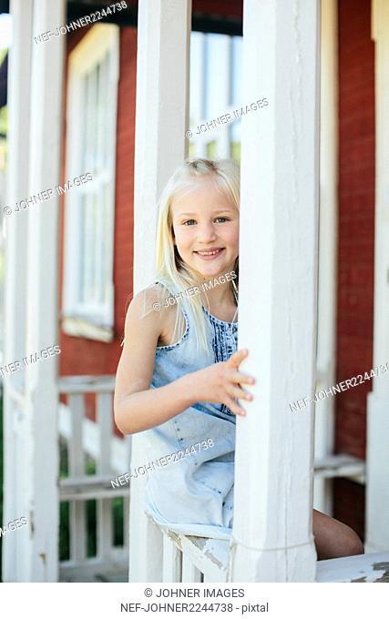 Girl sitting on porch