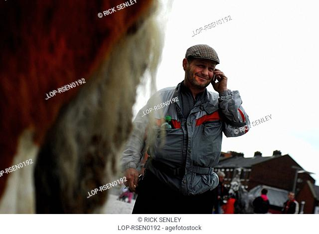 Republic of Ireland, Dublin, Smithfield Horse Market, A buyer on his mobile phone at Smithfield Horse Market in Dublin