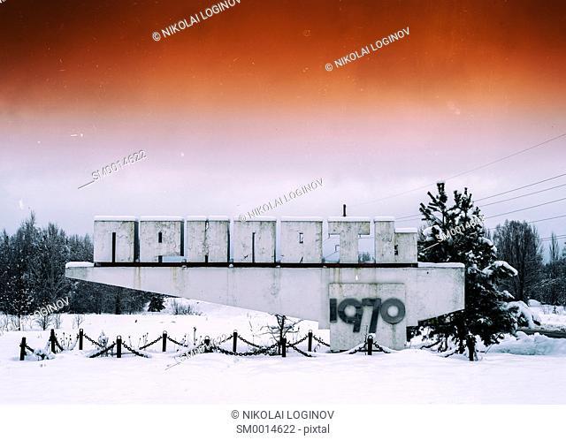 Horizontal vivid orange vintage radioactive Pripyat town sign background backdrop