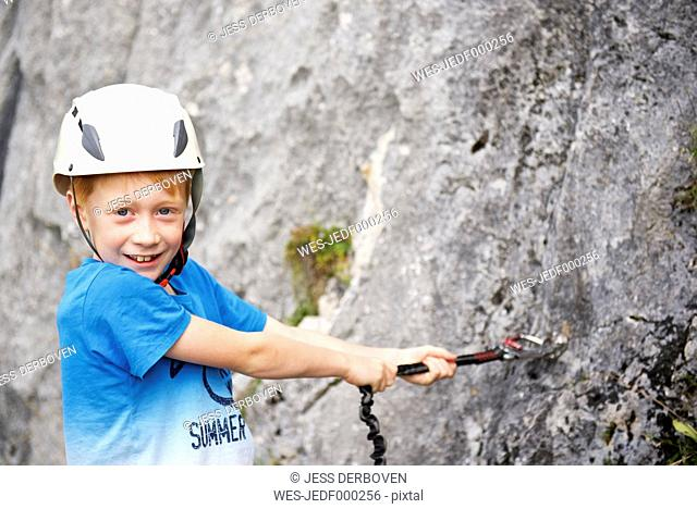 Austria, Tyrol, Rofan mountains, boy climbing