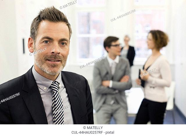 Businessman smiling in office