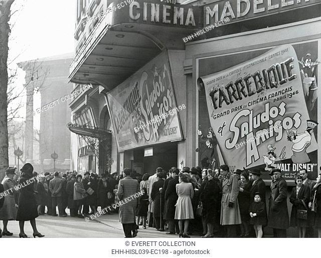 Parisiennes at a movie theater showing the Disney film, 'Saludos Amigos' in April 1947. At the Madeleine Cinema, Boulevard des Capucines, Paris
