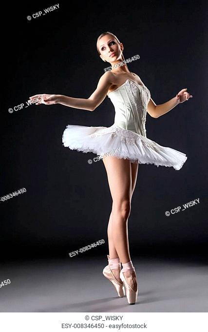 Image of cute young ballerina dancing in studio