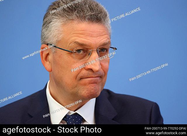 13 July 2020, Berlin: Lothar Wieler, President of the Robert Koch Institute (RKI), follows a joint press conference on Corona during vacation times with Health...