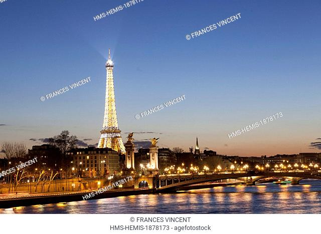 France, Paris, area listed as World Heritage by UNESCO, illuminated Eiffel Tower (© SETE-illuminations Pierre Bideau) over the pont Alexandre III bridge