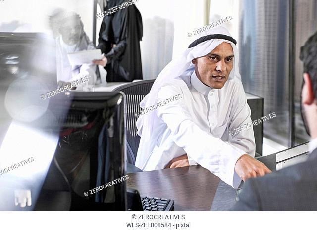 Businessman having meeting in Middle Eastern office
