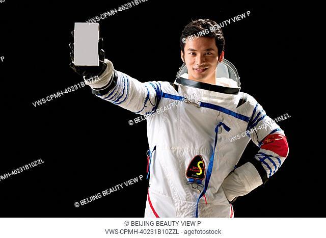 Astronaut holding milk