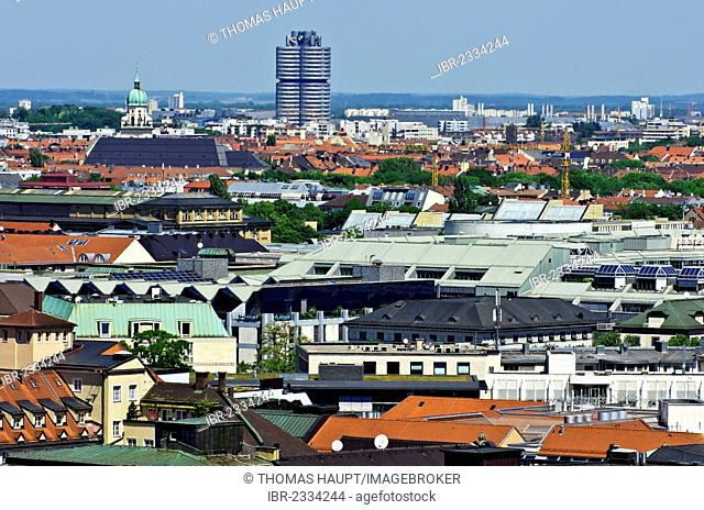 View over the roofs of Munich as seen from the steeple of the Church of St. Peter, headquarters of BMW, a car manufacturing company, and the television tower