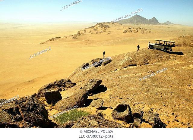Tourists Overlooking a Vast Desert Landscape  Namib Desert, Namibia