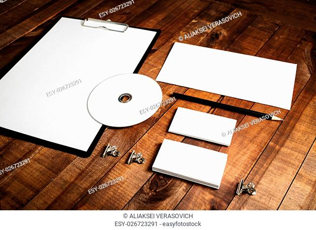 Blank stationery set. Corporate identity template on vintage wooden table background. Mock-up for design presentations and portfolios