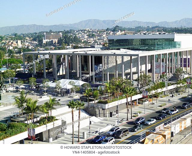 Los Angeles County Music Center. The Mark Taper Forum is the round building at center and the Ahmanson Theater is the large glass-fronted building at right