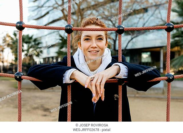 Portrait of smiling young woman on a playground