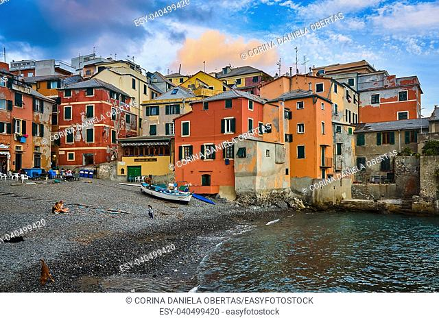 BOCCADASSE, GENOA, ITALY - OCTOBER 5, 2009: People enjoying the sunset on the small beach of Boccadasse, fishermen district in the suburbs of Genoa