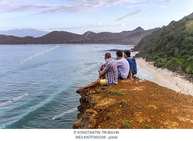 Indonesia, Sumbawa island, Young people sitting on viewpoint