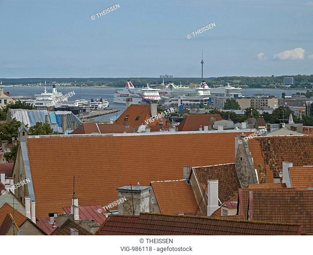 overview over the old town of Tallinn with red roofs, Baltic Sea with ship dock in the background, Tallinn, Estonia. - 02/08/2008