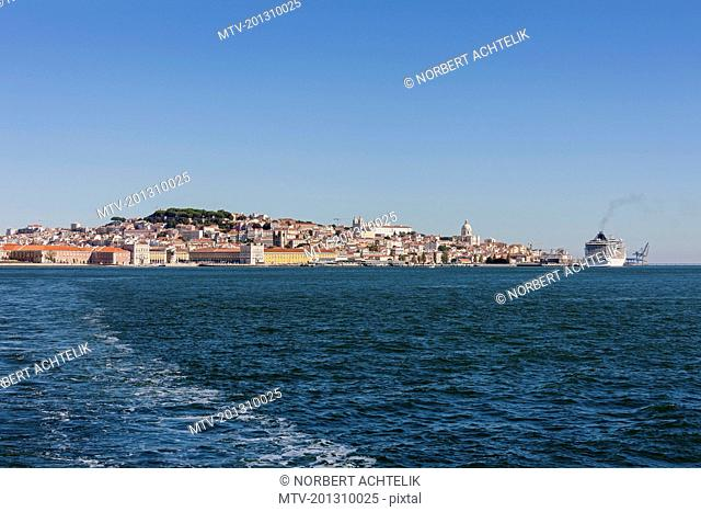 Distant view of city at waterfront, Lisbon, Portugal