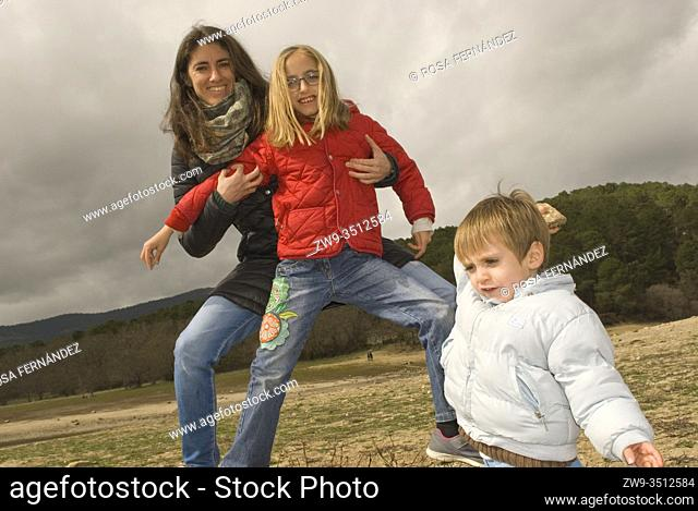 Mother and children playing at the country, Guadarrama Range, Madrid, Spain