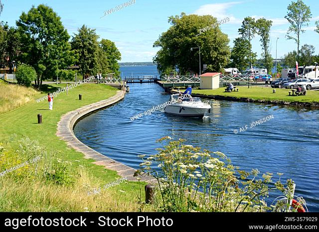 Leisure boats leave the locks in Gota Canal at Borenshult, Motala, Östergötland, Sweden. The Gota Canal was constructed in the 19th century