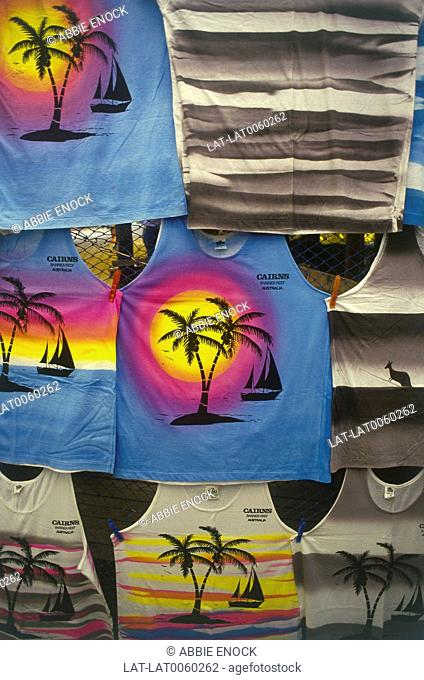 Display of T-shirts with Cairns on front for sale in Kuranda