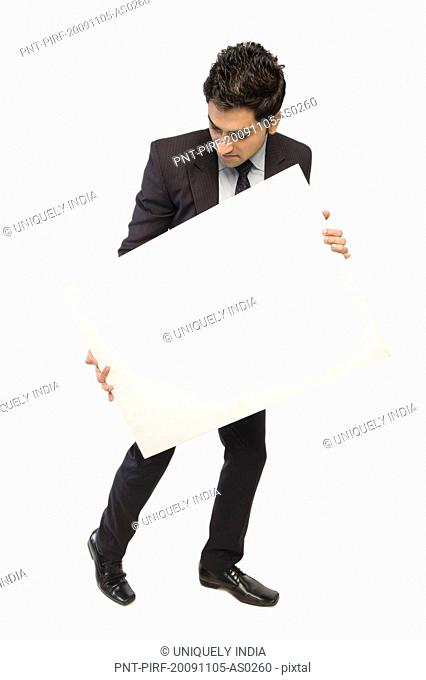 Close-up of a businessman showing a blank placard