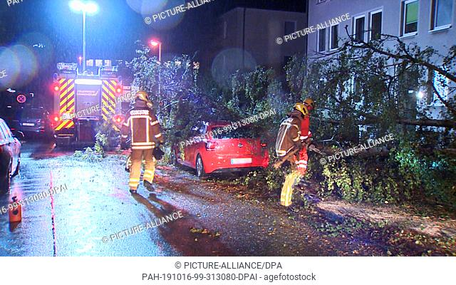 16 October 2019, Lower Saxony, Hanover: This video still shows firefighters in action after a tree fell on a car. The fire brigades in the Hanover region have...