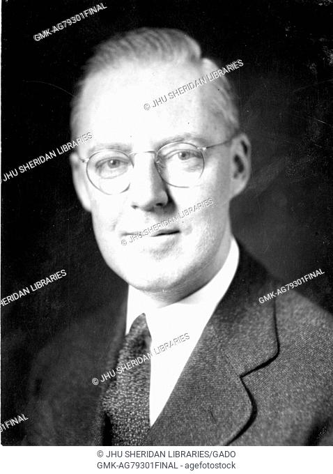 Portrait, shoulders up, of Howard Earl Cooper, professor of business and president of McCoy College, later renamed to Carey Business School
