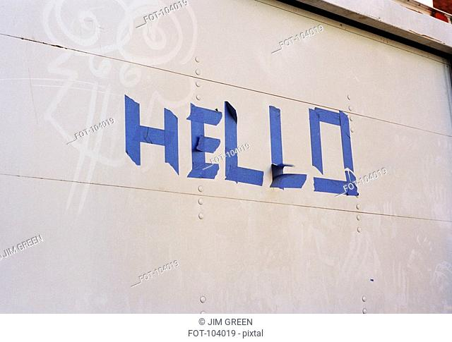 Hello' in adhesive tape on a wall