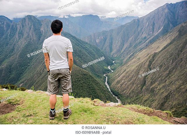 Man looking at view of Intipata, Inca Trail, Huanuco, Peru, South America