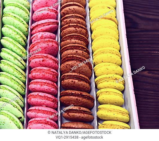 Colorful macarons in a paper box, close up