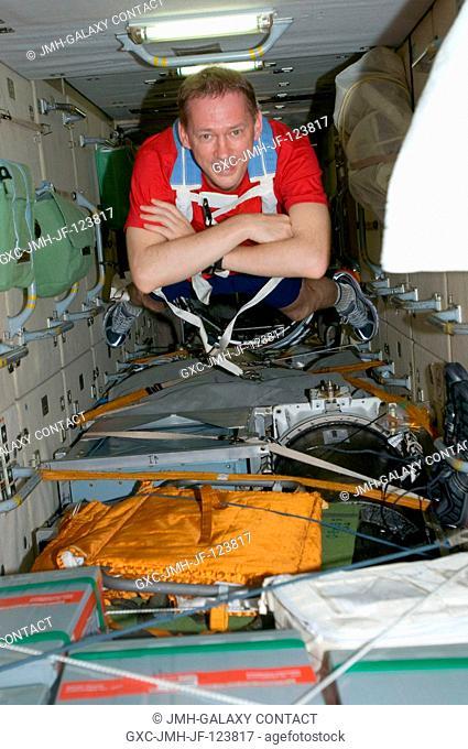 European Space Agency astronaut Frank De Winne, Expedition 20 flight engineer, floats through the Zarya functional cargo block (FGB) of the International Space...