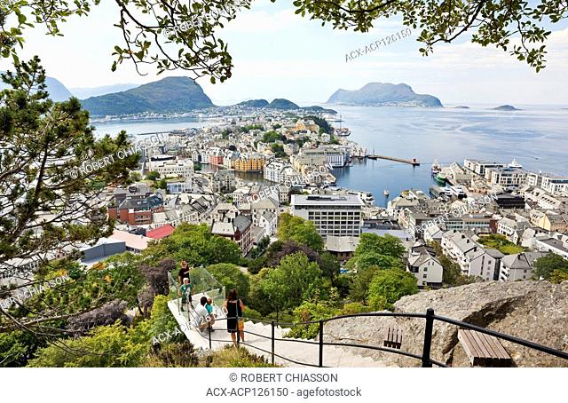 Family halfway up a path that leads from the Town Park to top of Mount Aksla and that offers panoramic views of the city of Alesund, Norway