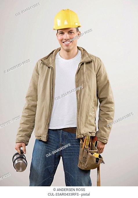 Man wearing hard hat and utility belt