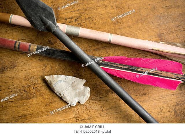 Arrows and arrowhead on table