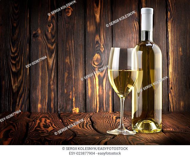 Desser white wine on a wooden background