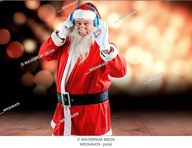 Santa gesturing while listening music on headphones