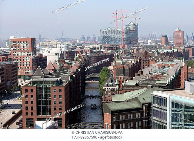 The historic Speicherstadt(C) in HafenCity (L) with the Elbe Philharmonic Hall (back) is pictured from a tethered hot-air balloon in Hamburg, Germany